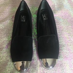 Black flats with silver toe